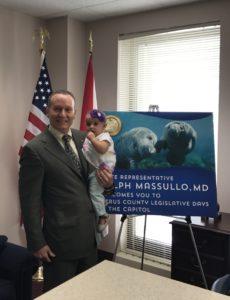 dr. Ralph Massullo holding baby
