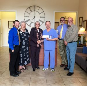 Dr. Ralph Massullo receiving donation