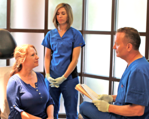 Dr. Ralph Massullo consulting patient