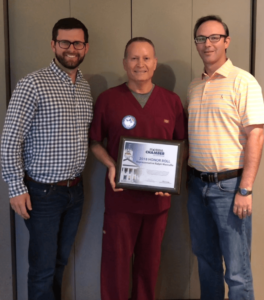 The Florida Chamber presents award to Dr. Ralph for the 2018 Honor Roll